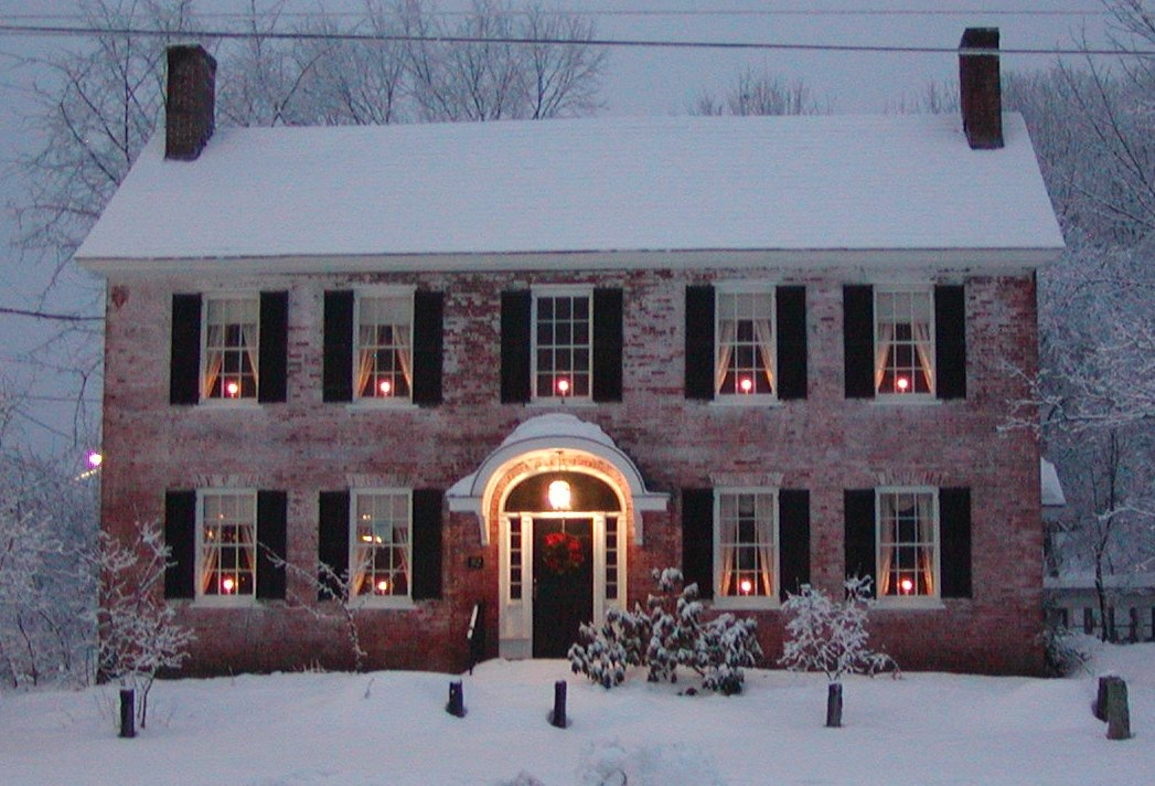 Christmas decorated brick two story home