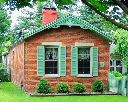 brick cottage with green trim