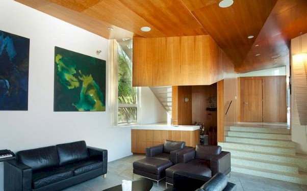Living room ceilings of this Franklin Hills home add drama to the setting