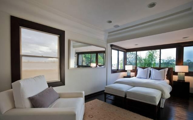 Views of the hills and natural light spill through bedroom windows of this Silver Lake Spanish