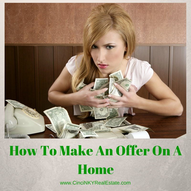 picture of a lady holding money for article how to make an offer on a home