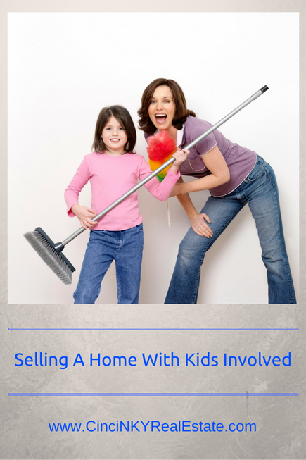 selling a home with kids involved picture of mother and daughter cleaning