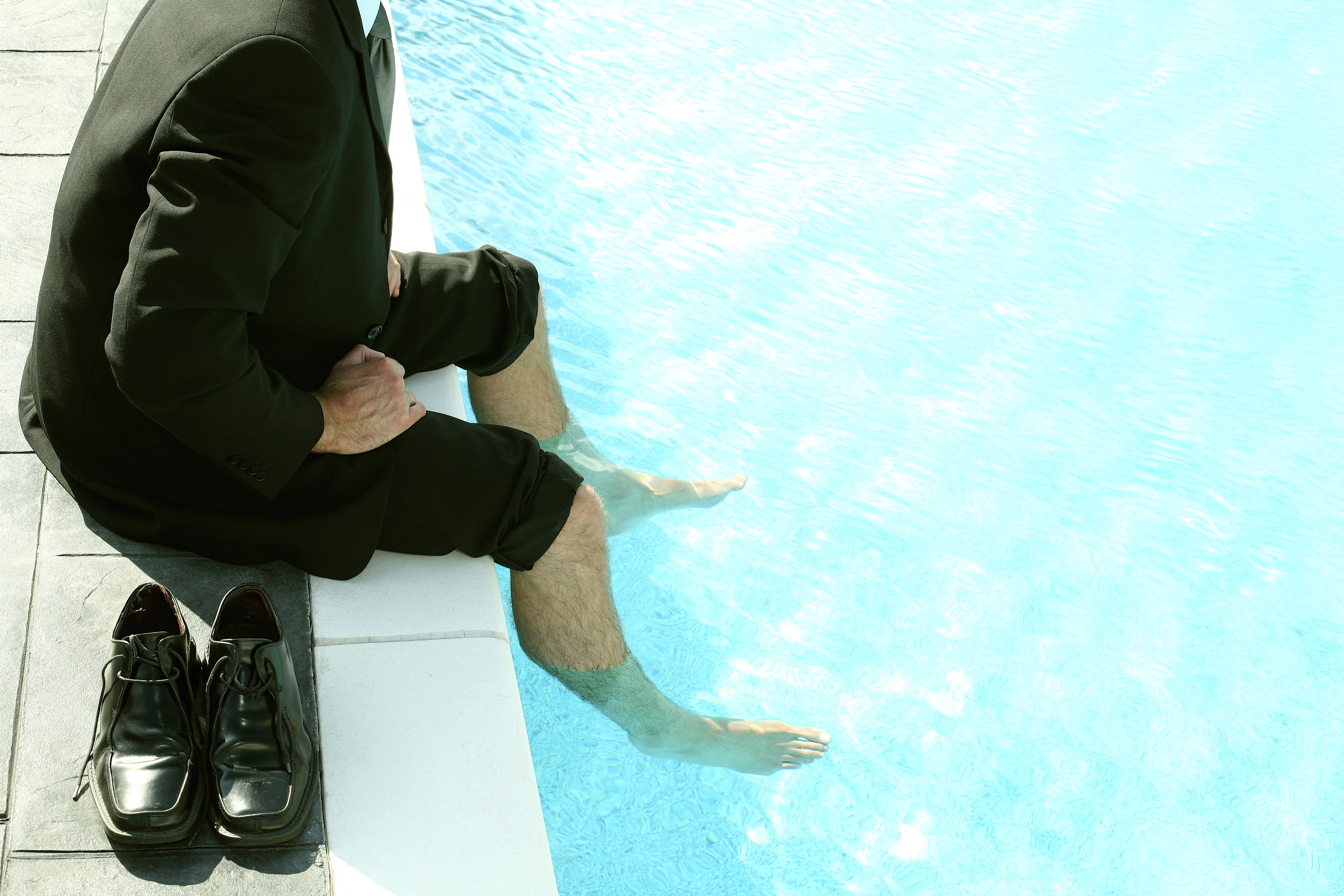 business man in suit by pool