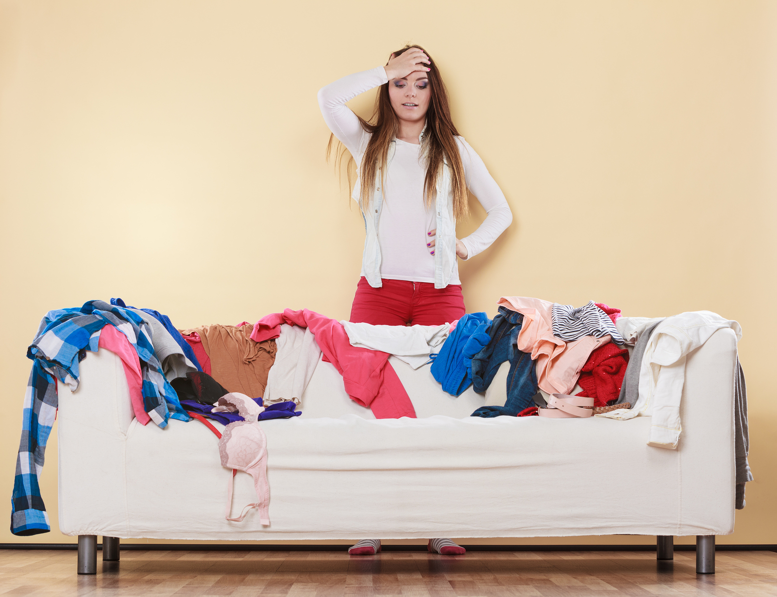 woman in dirty room not ready for house showing