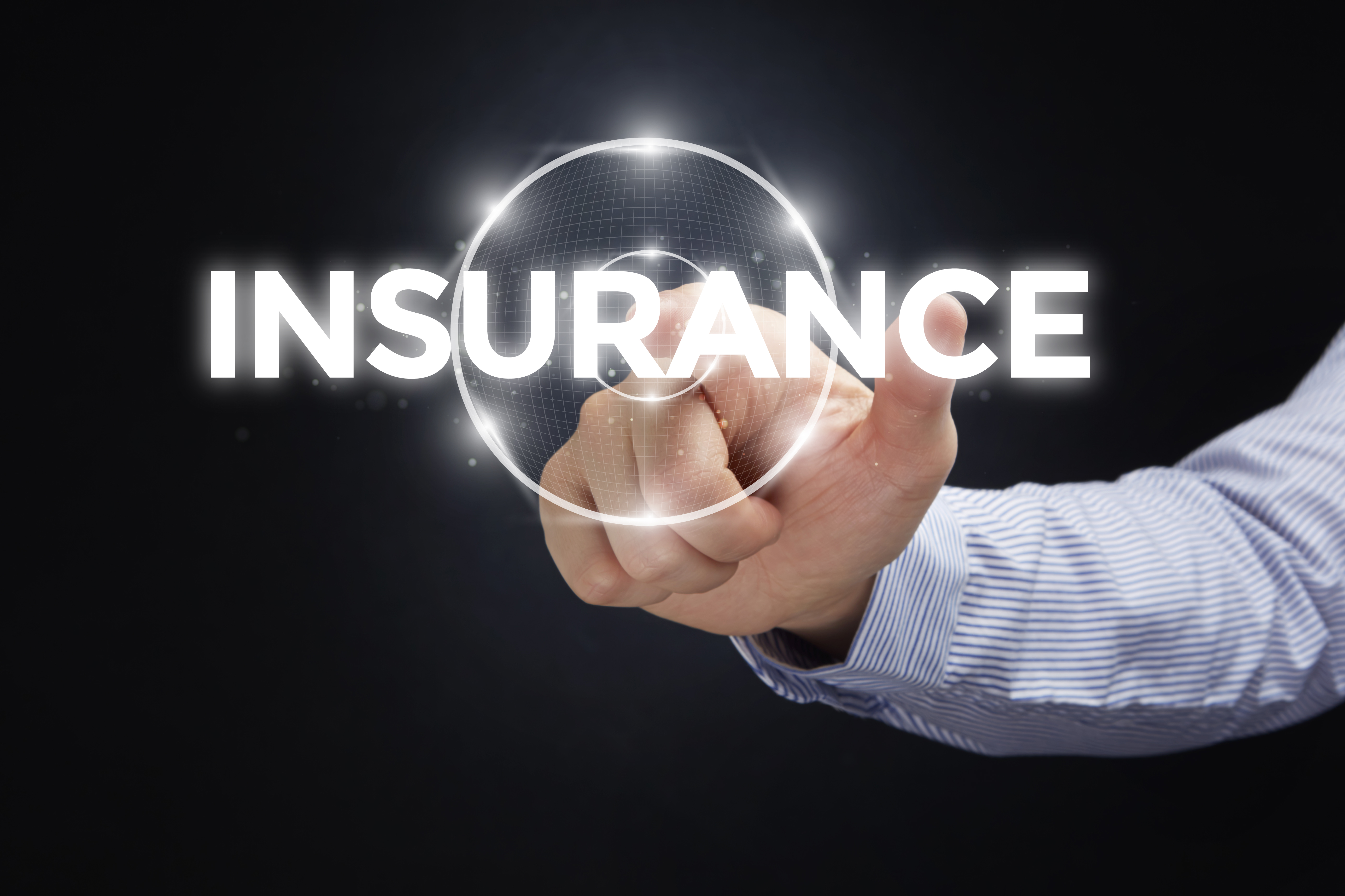 finger pointing at insurance text
