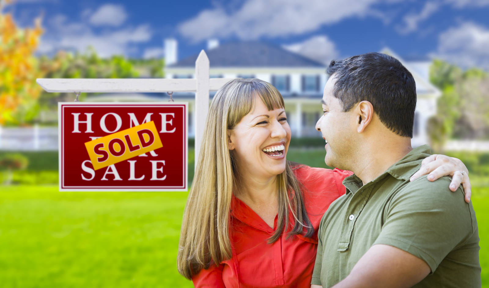 happy couple after house has been sold