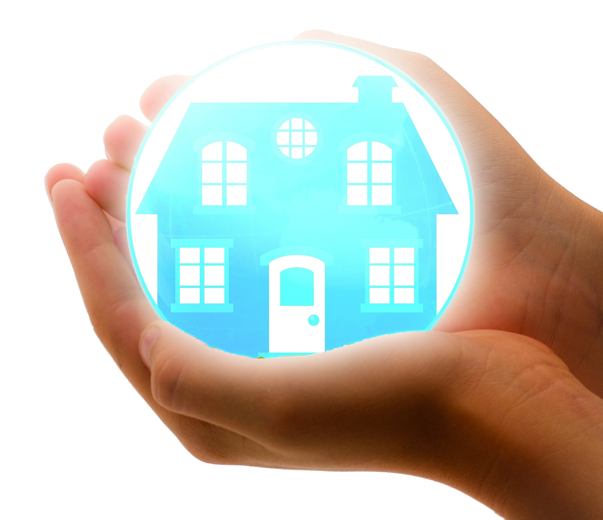 picture of a hand holding a home, conveying security from a home warranty and homeowners insurance