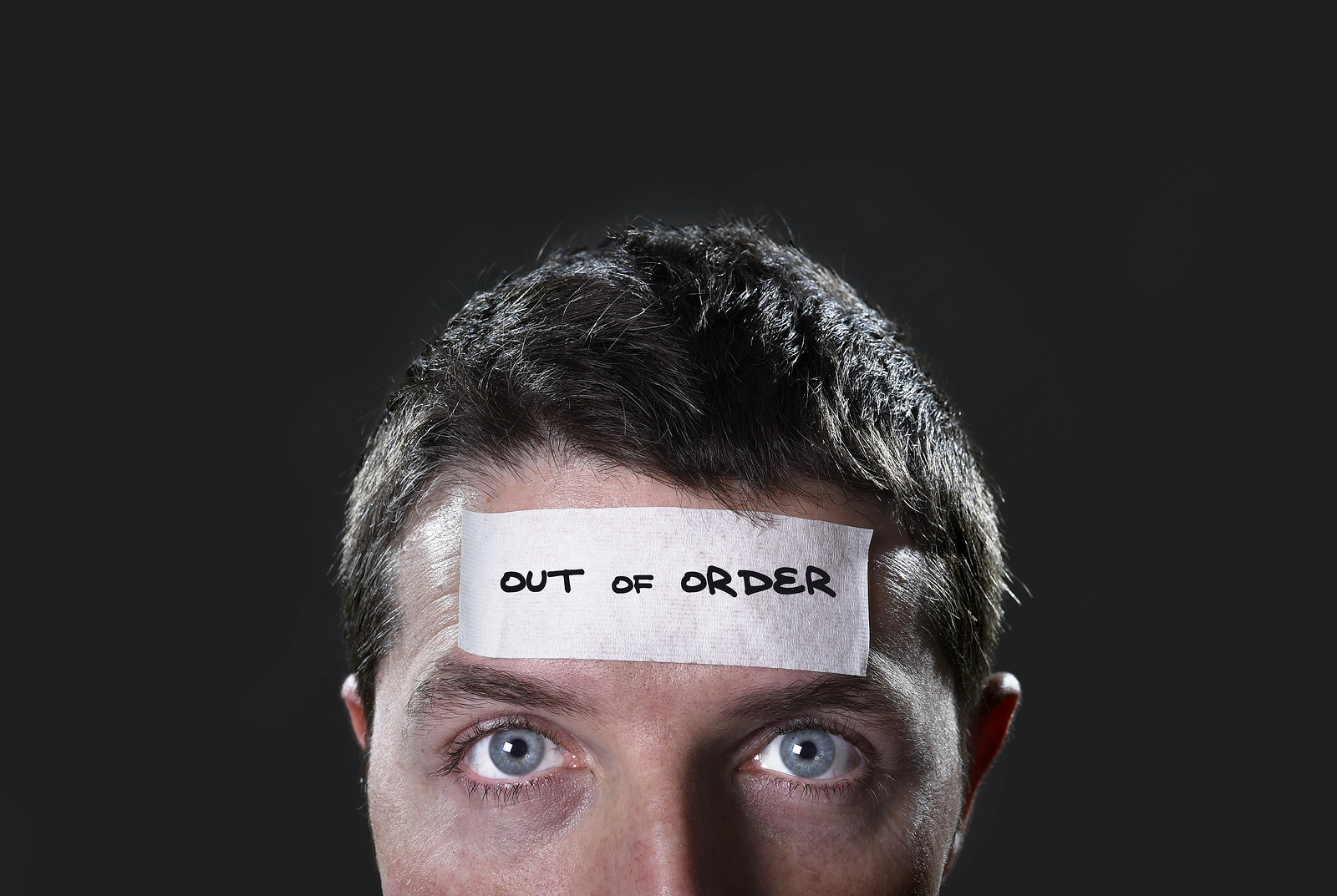 man with out of order sticker on head to show lack of communication for real estate deal
