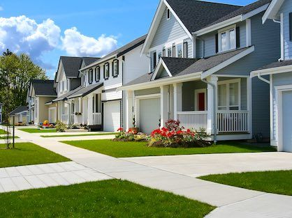 A neighborhood of newer Craftsman style homes.