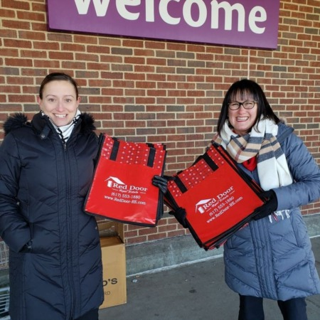Quincy MA's Red Door Real Estate Gives Back with Free Reusable Shopping Bags Amidst New Plastic Bag Ban