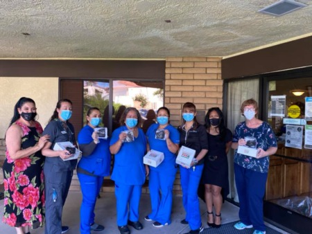 Local real estate team delivers 300 doughnuts & masks to nurses