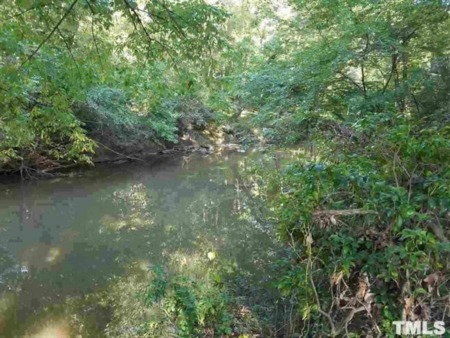 Under Contract in Timberlake! 2 Acre River Lot!