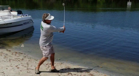 Guy wearing an FWC shirt hits golf balls at Dolphins?!?! [VIDEO]