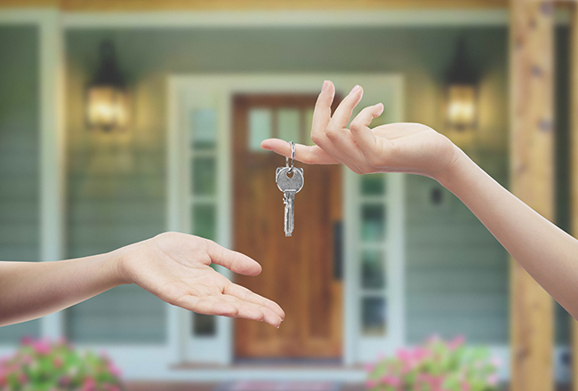 Seller Passing House Keys to Buyer