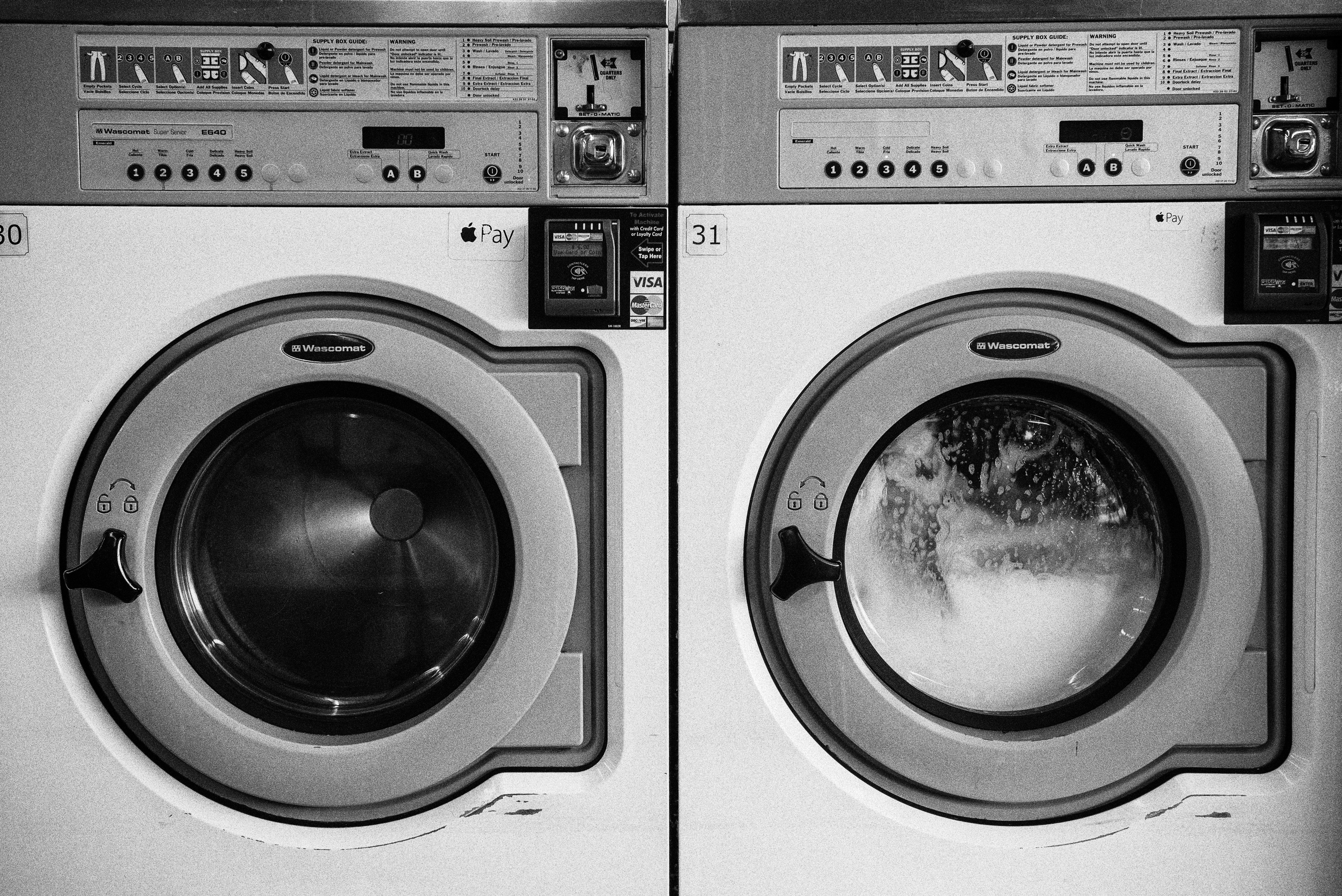 greyscale photo of washer and dryer laundry machines
