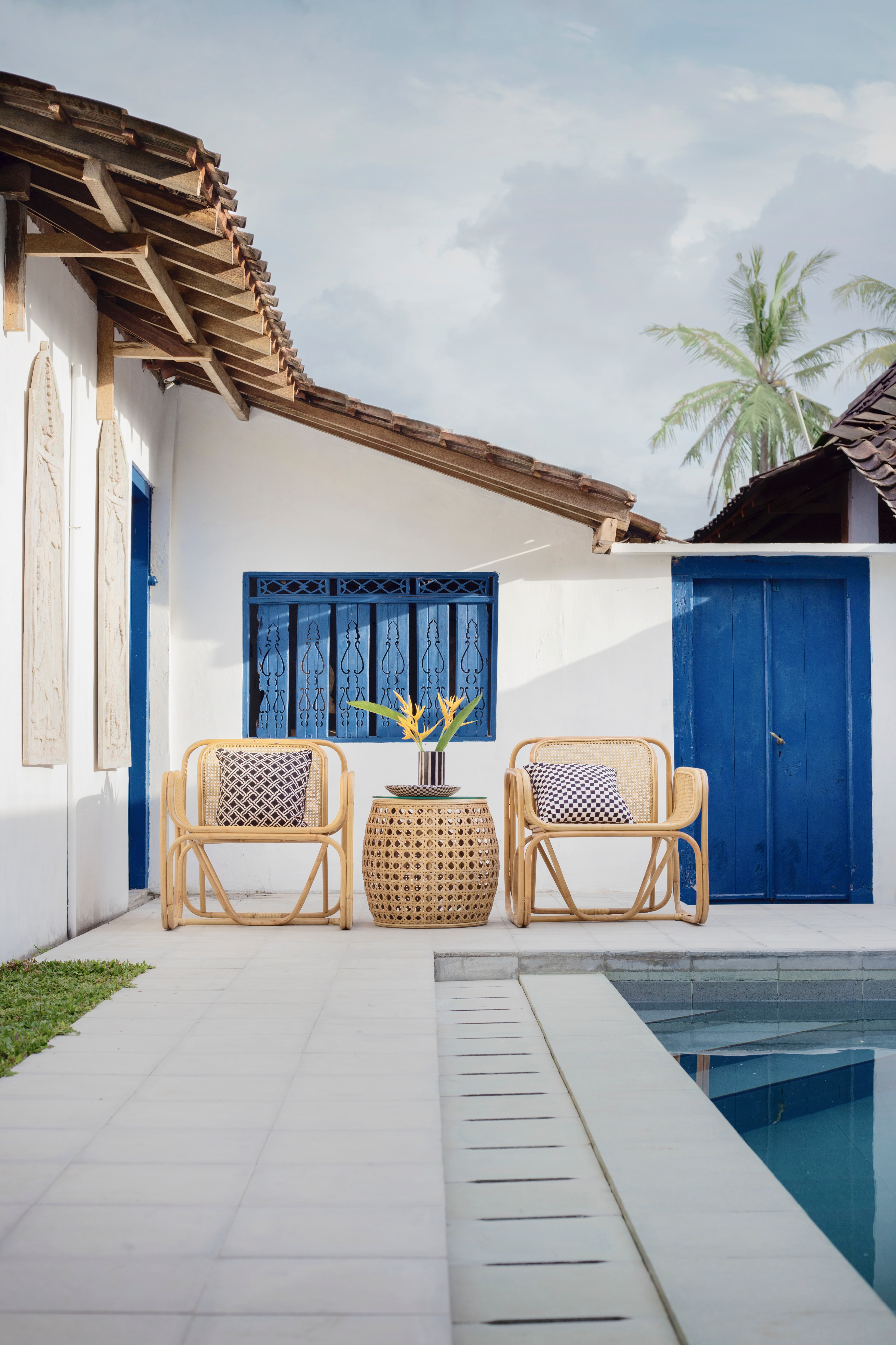 wicker table and chairs near swimming pool