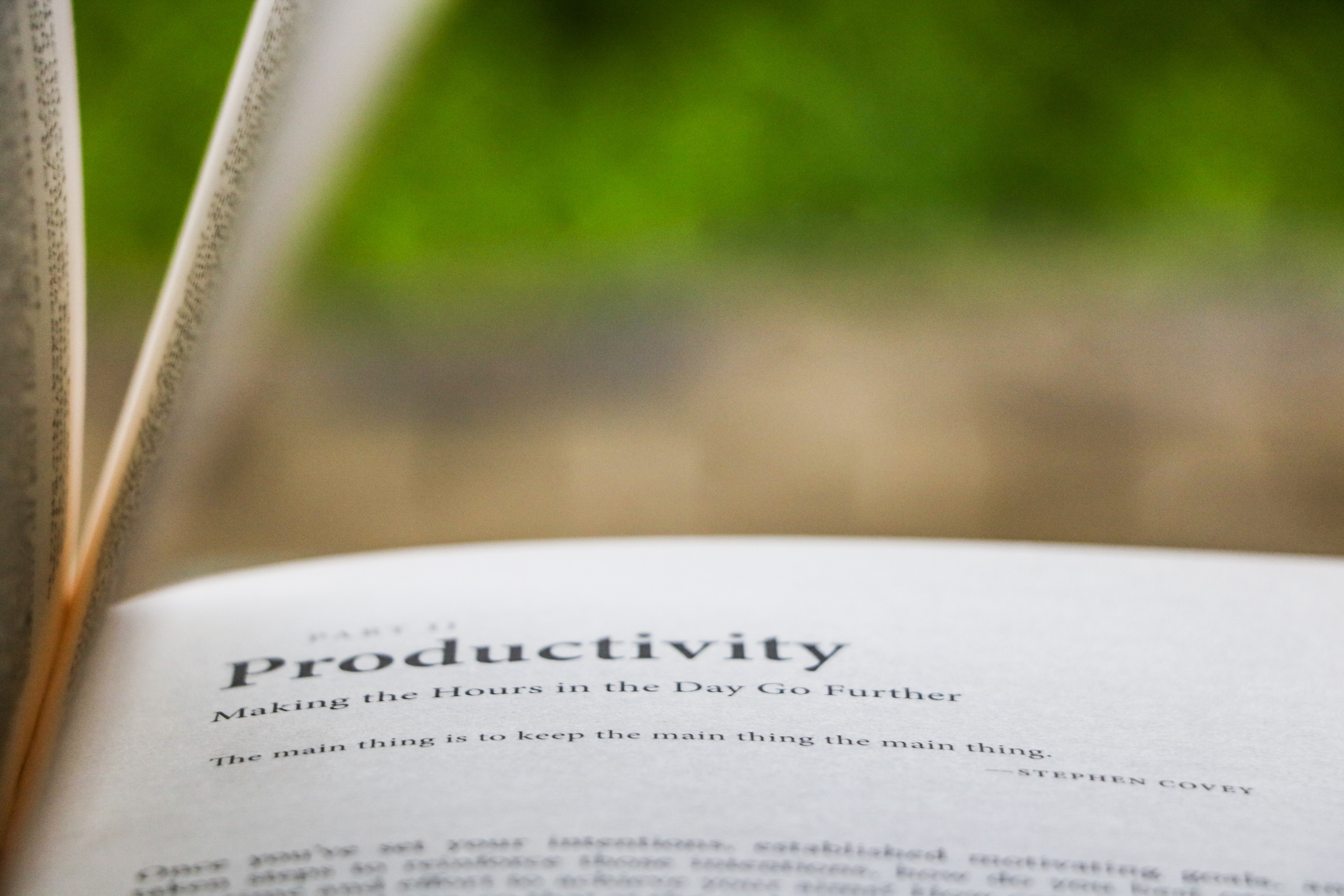 selective focus on book about productivity