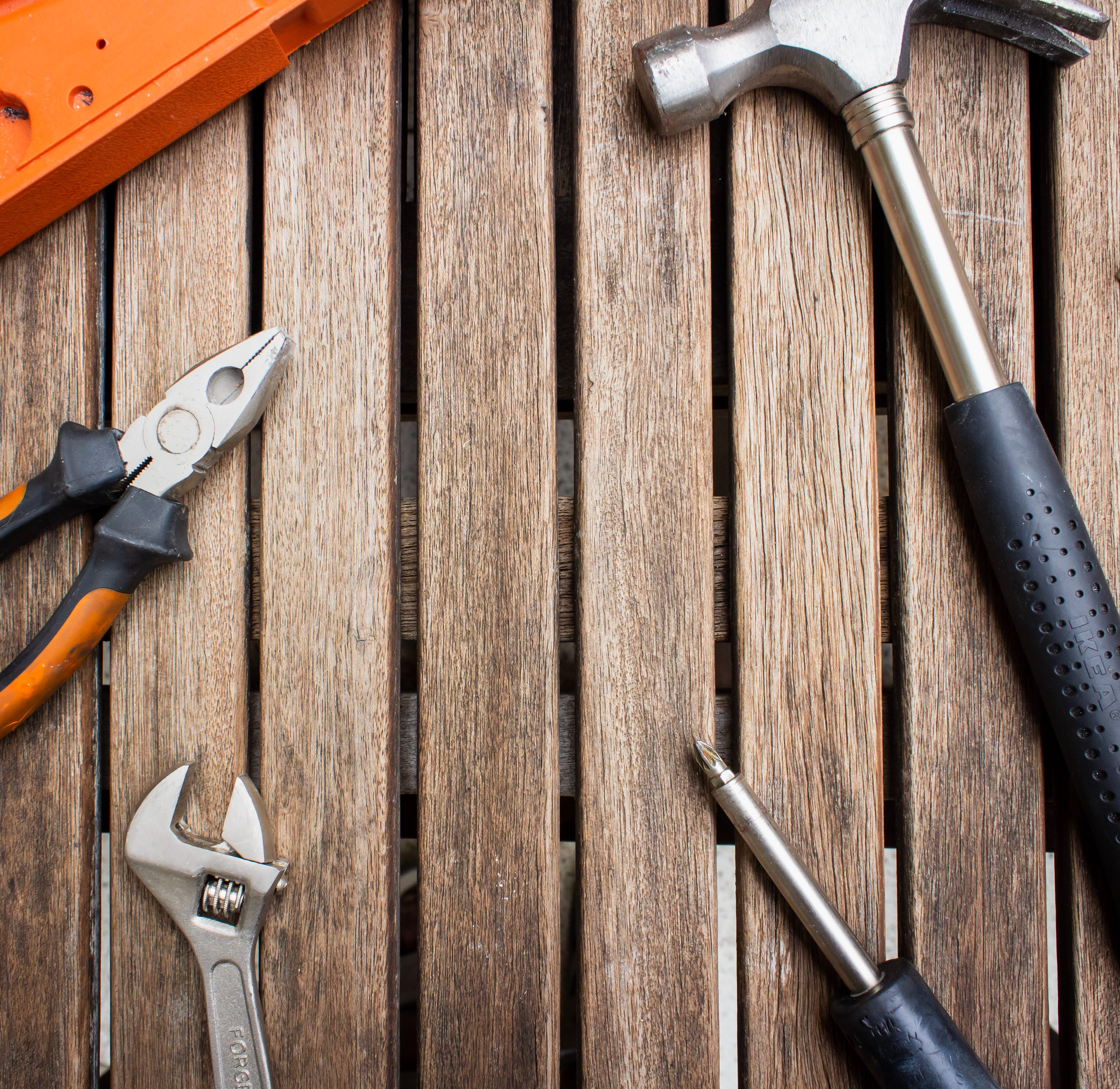 Assorted tools on a brown background