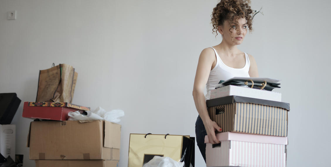 A frustrated woman carrying boxes
