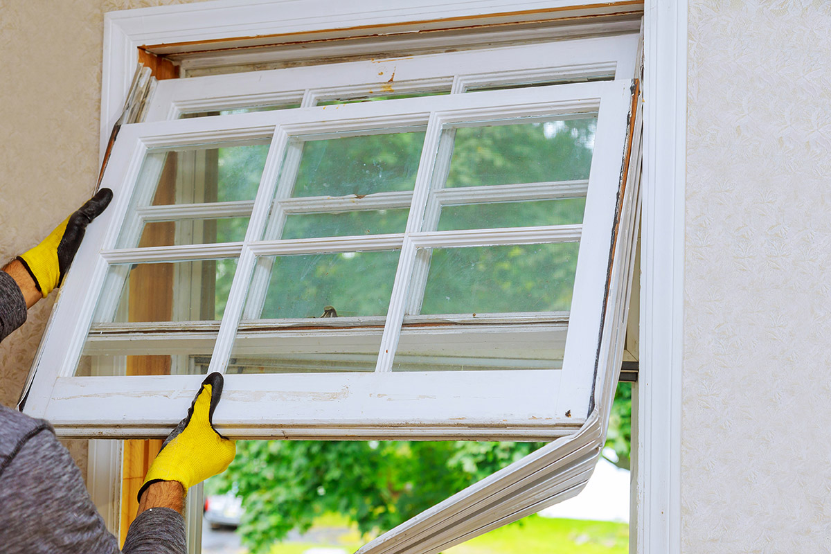 Taking out old windows with low energy efficiency