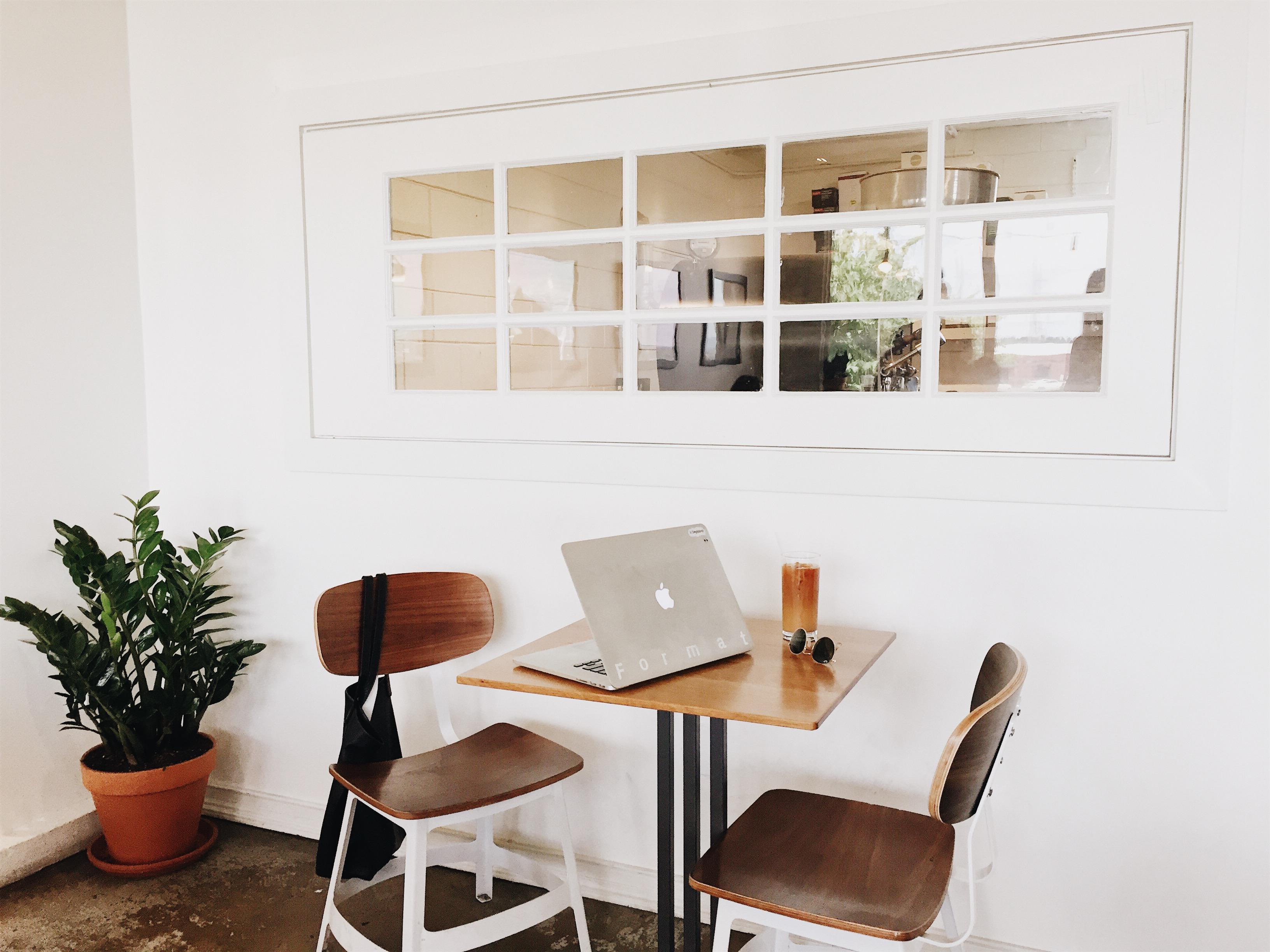 MacBook on Brown Wood Dining Table