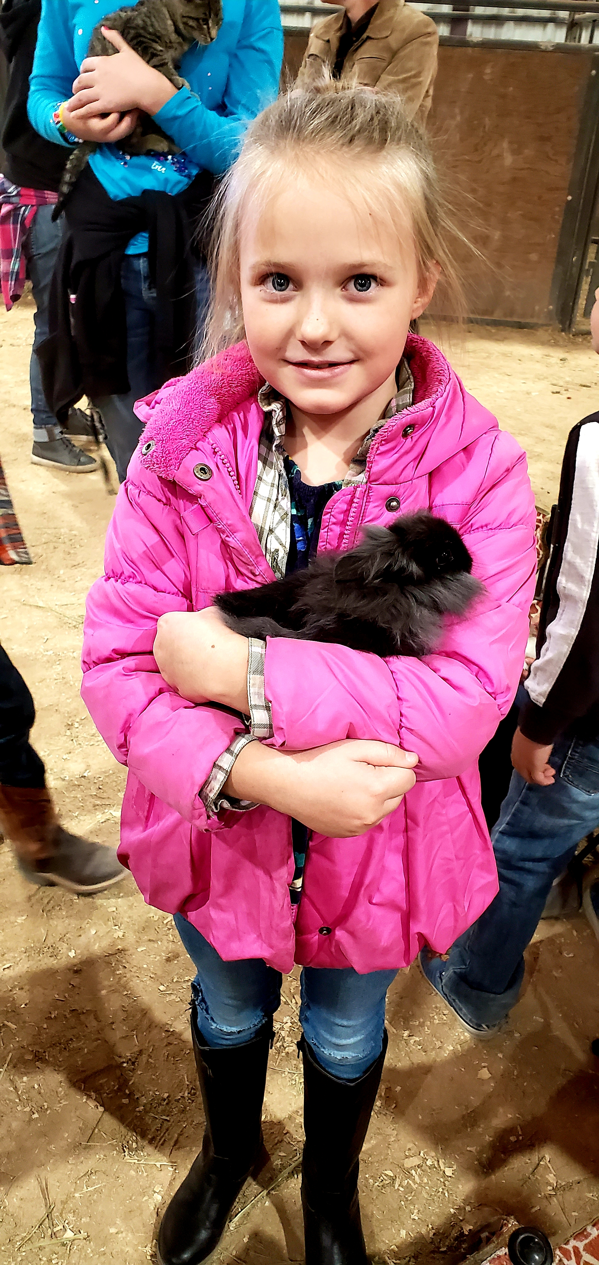 Young girl holding a small rabbit