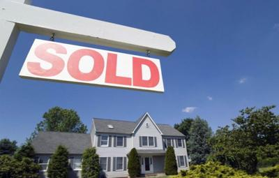 Sold sign in front of a house