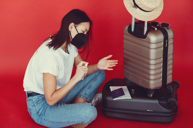 Woman with facemask preparing for travel