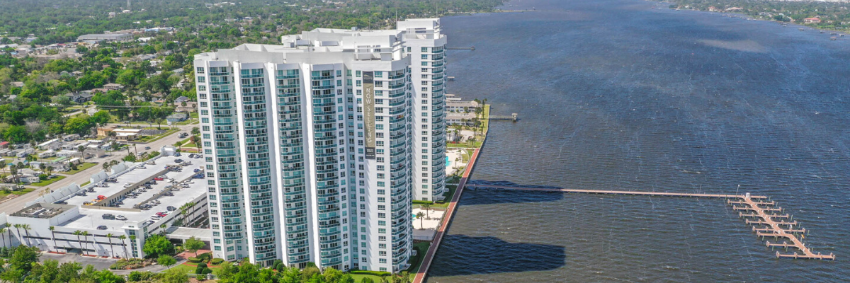 photo of a riverfront condo building