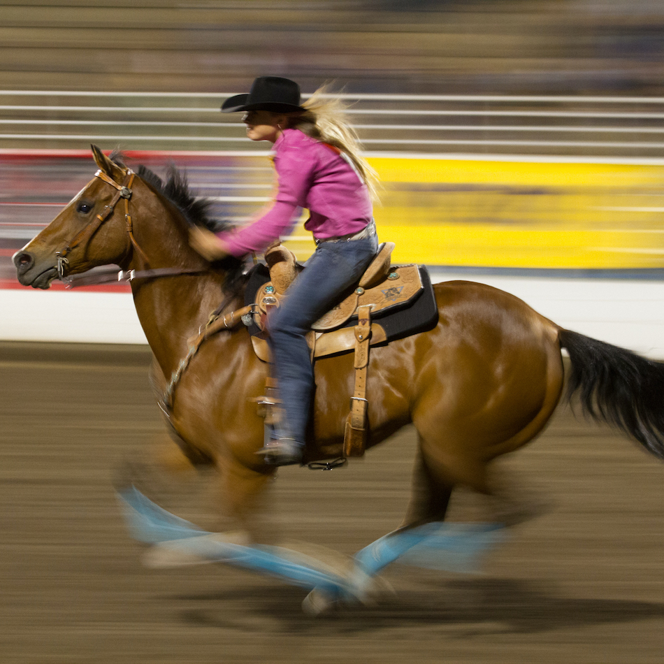 Woman Riding a Horse at Steamboat Springs Rodeo
