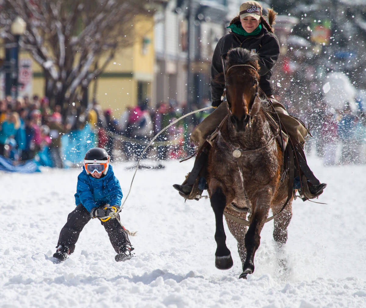 Woman and Child Racing at the Steamboat Springs Winter Festival