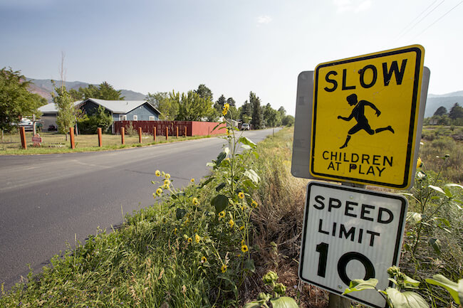 Goodman Neighborhood Children at Play and Speed Limit Signs in Durango Colorado