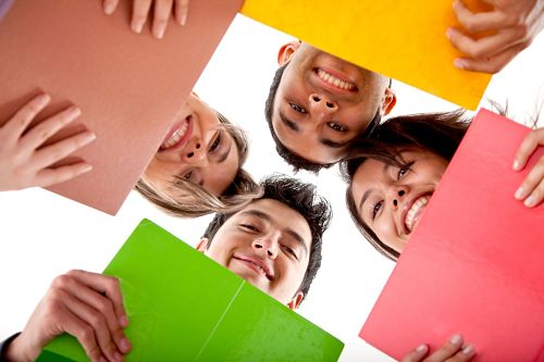 Students holding colorful folders