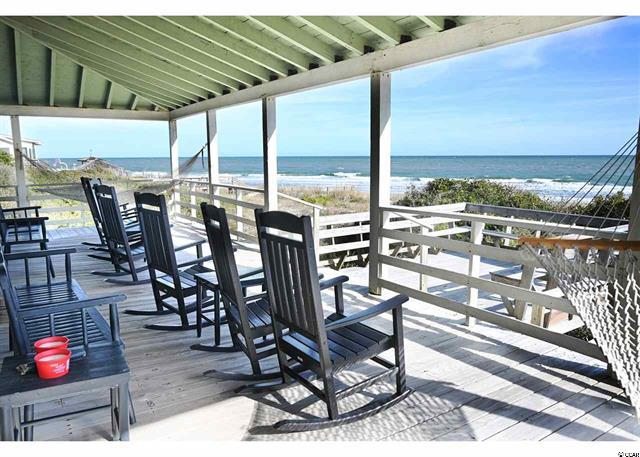 Back porch with rocking chairs oceanfront in Pawleys Island