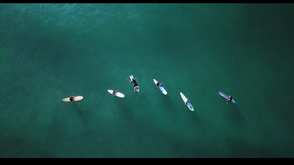 Surfers floating in the Ocean in Carolina Beach