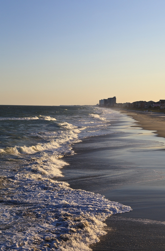 Surfside Beach with water and sand