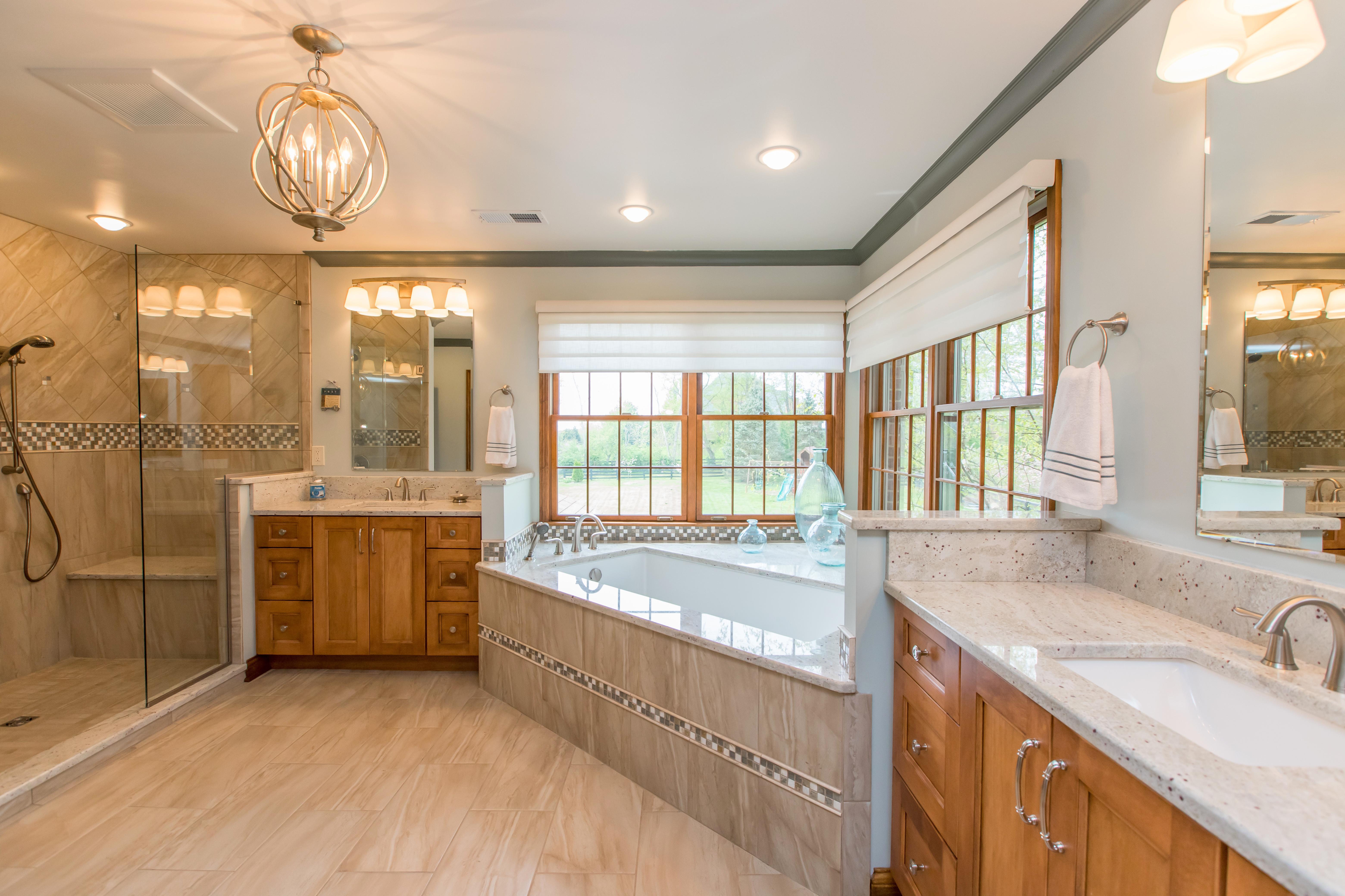 Remodeled bathroom with dual vanities and granite tops