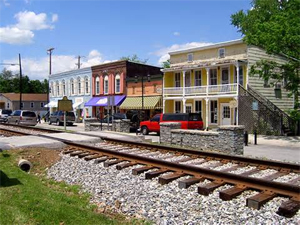 Downtown Midway KY at Railroad tracks and buildings in background