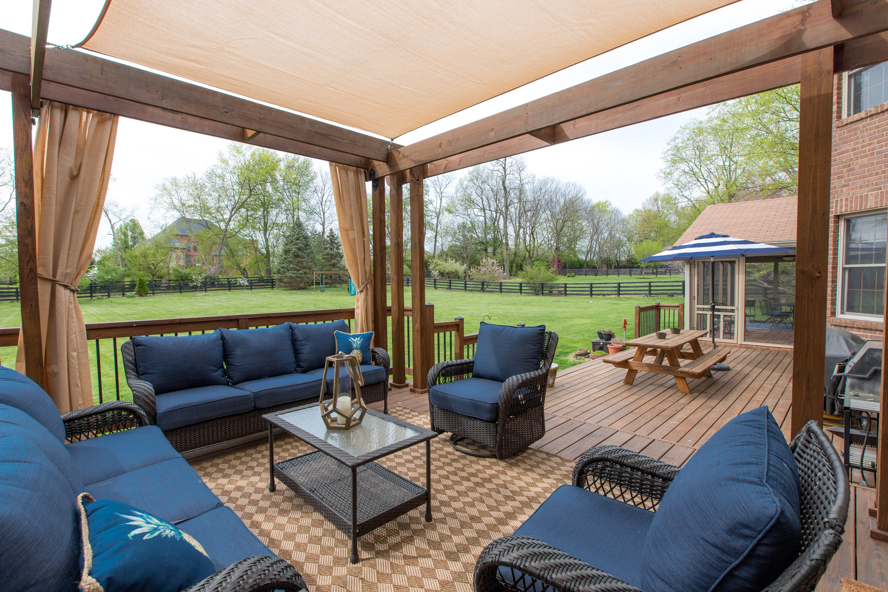 patio with seating under neath and pergola style design