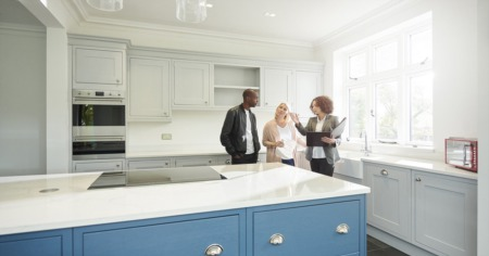 Buyers and Realtor in kitchen area talking