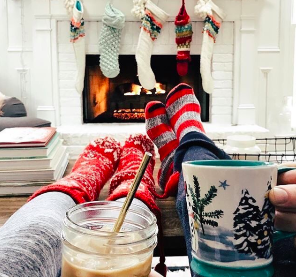 Sitting in front of the fire place with hot chocolate