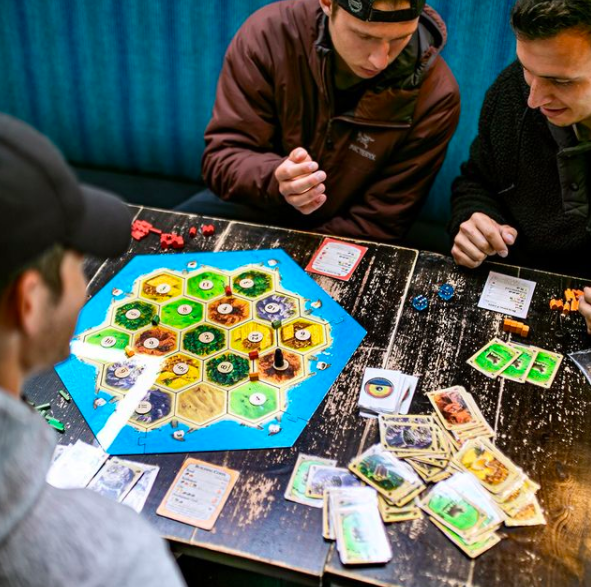 Playing games at a cafe in Calgary, AB
