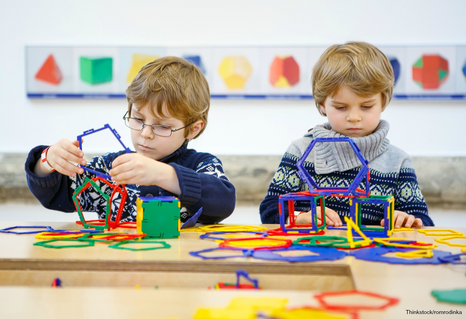 Kids playing at desk with learning toys