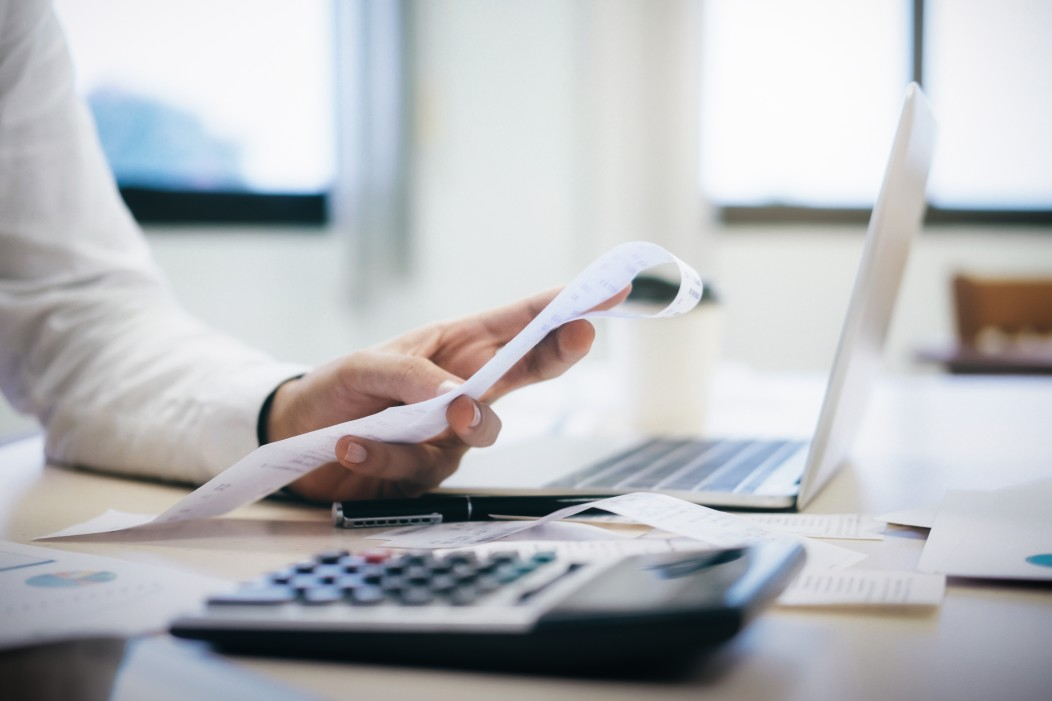 financial-officers-calculate-expenses-from-cash-bills