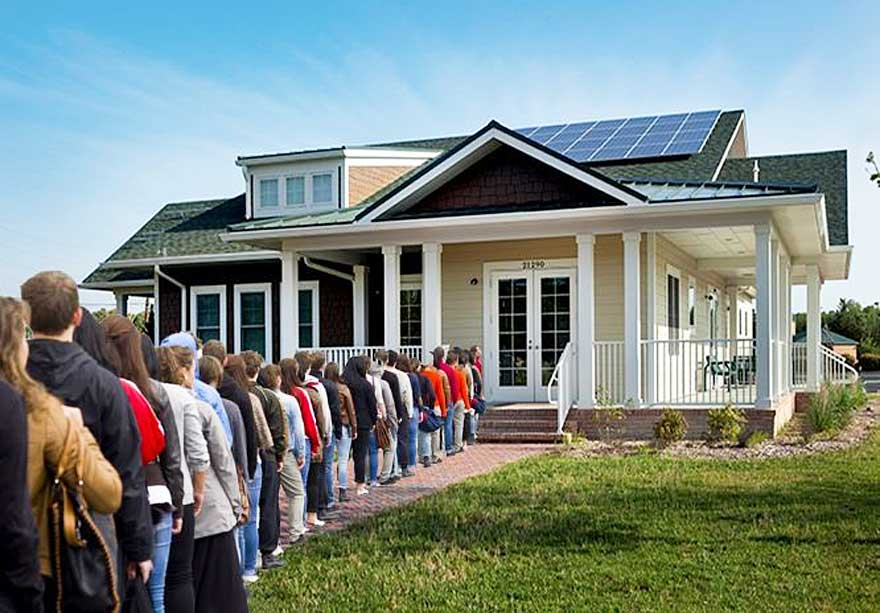 people line up in front of house to make an offer