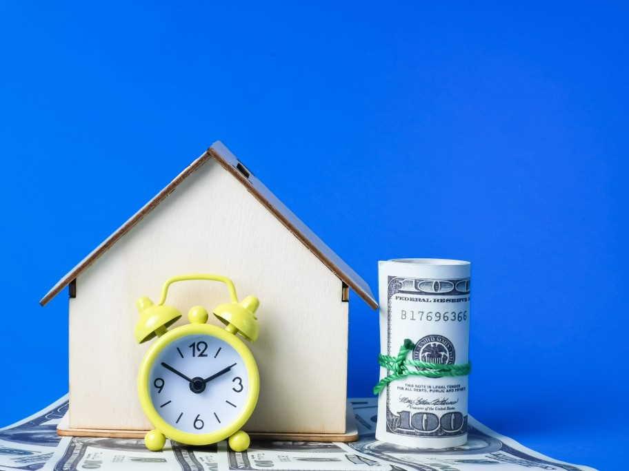 alarm-alarm-clock-apartment-arranged-assurance-building-business-buying-clock-concept-currency