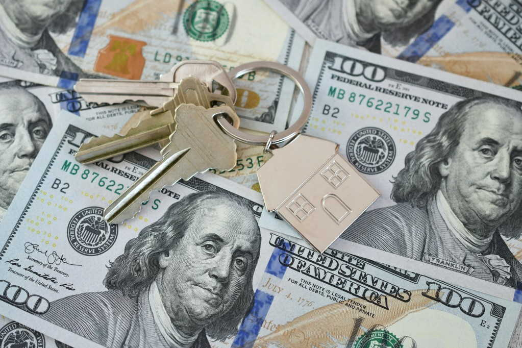 buying-selling-refinancing-real-estate-concept-house-keys-on-money-currency-home-loan-equity-buy-sell