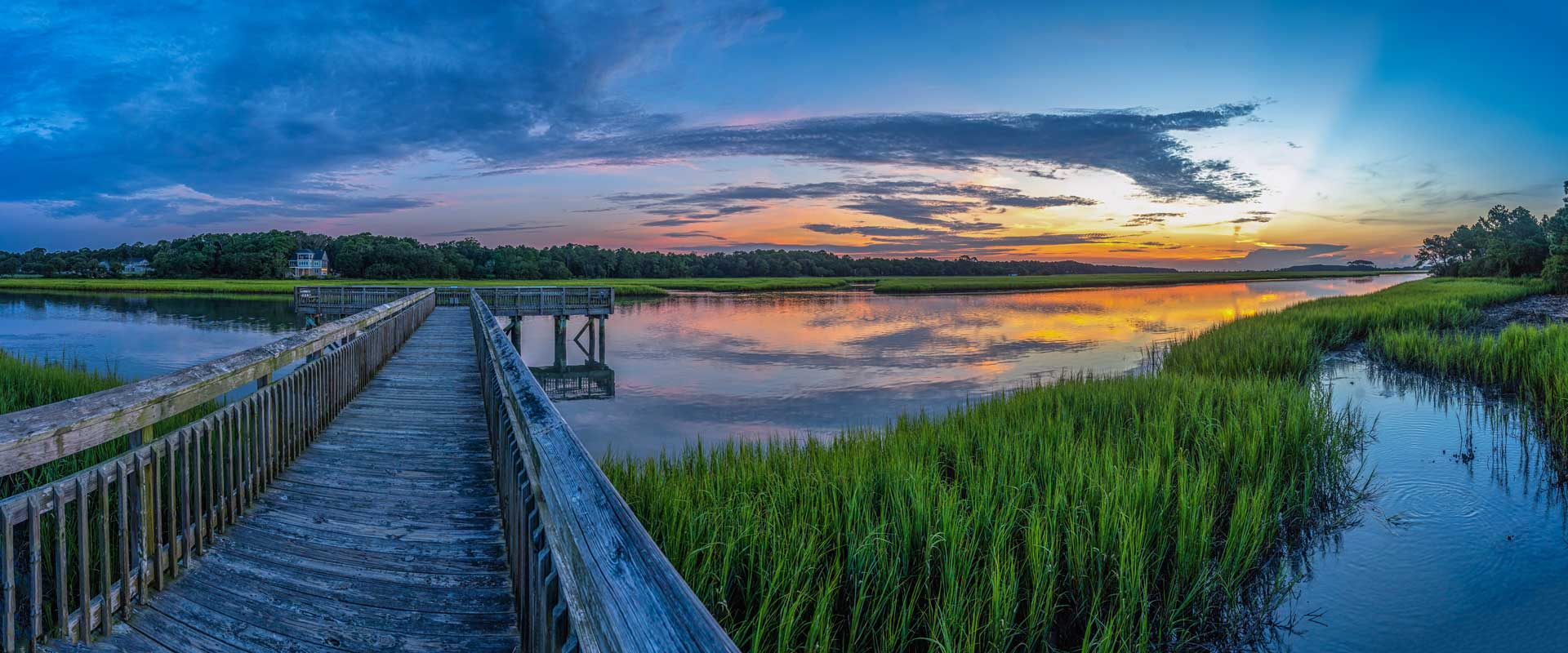 Awendaw, Sc at Sunset with a dock a sweetgrass