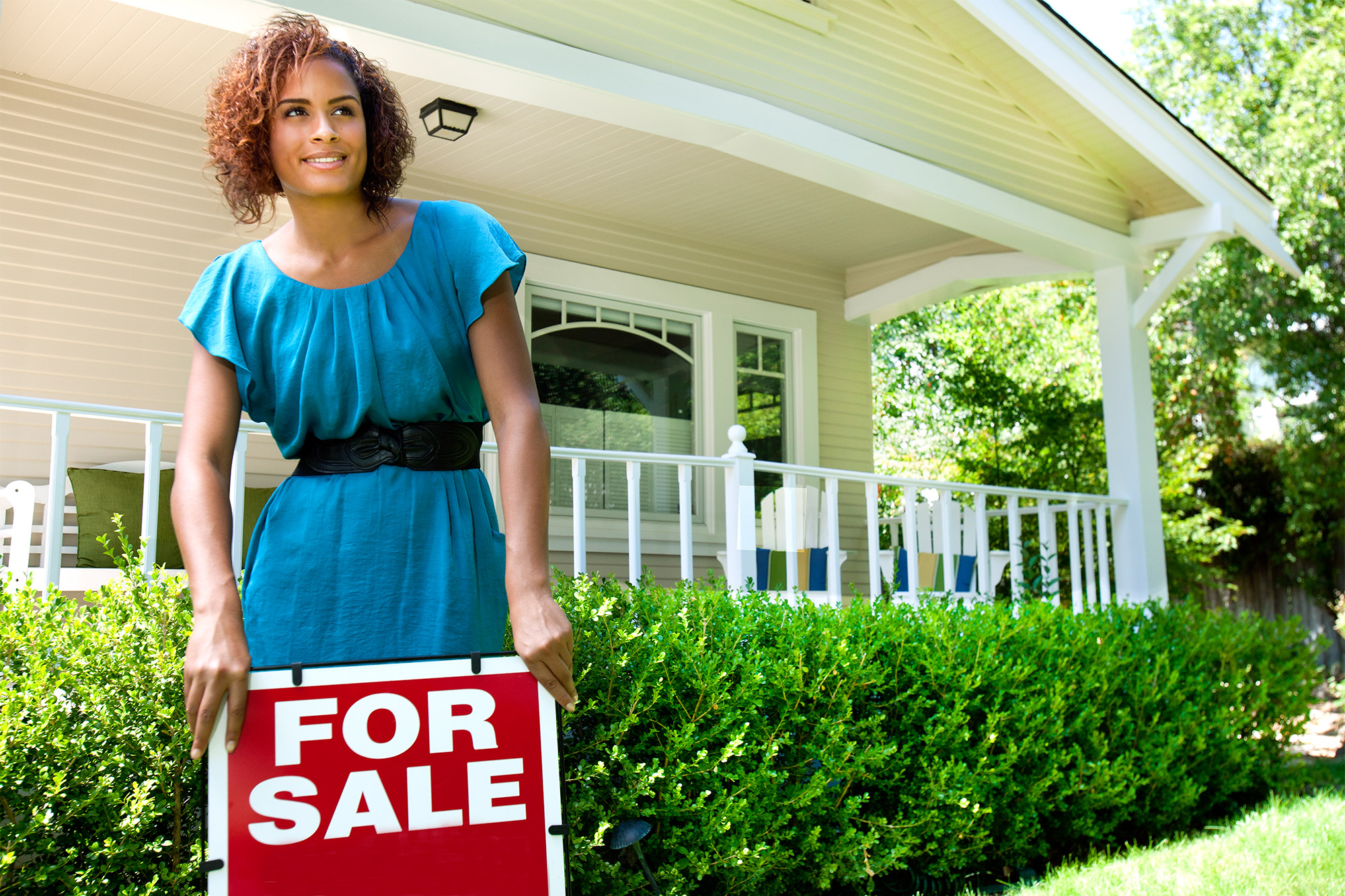 Realtor with sign