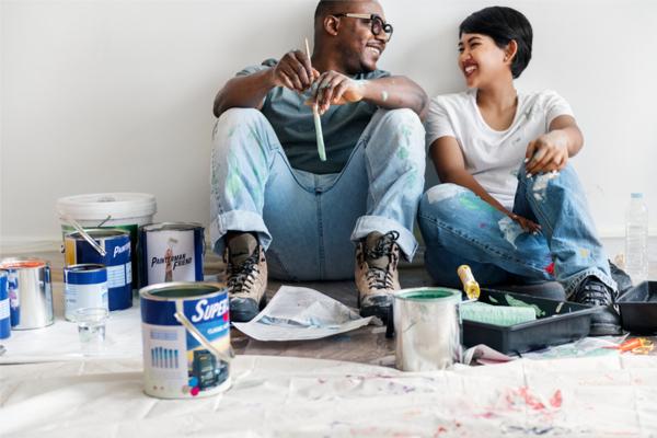 Happy couple renovating